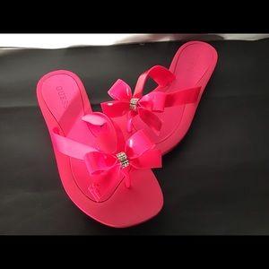 Bright pink flip flops